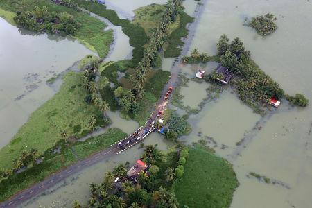 An aerial view shows partially submerged road at a flooded area in the southern state of Kerala, August 19, 2018. REUTERS/Sivaram V