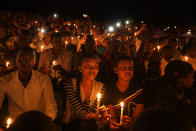 """FILE - In this Sunday, April 7, 2019 file photo, people attend a candlelit vigil during a memorial service marking 25 years since the genocide, at Amahoro stadium in the capital Kigali, Rwanda. France's role before and during 1994's Rwandan genocide was a """"monumental failure"""" that the country must face, the lead author of a sweeping report commissioned by President Emmanuel Macron said, as the country is about to open its archives from this period for the first time to the broader public. (AP Photo/Ben Curtis, File)"""
