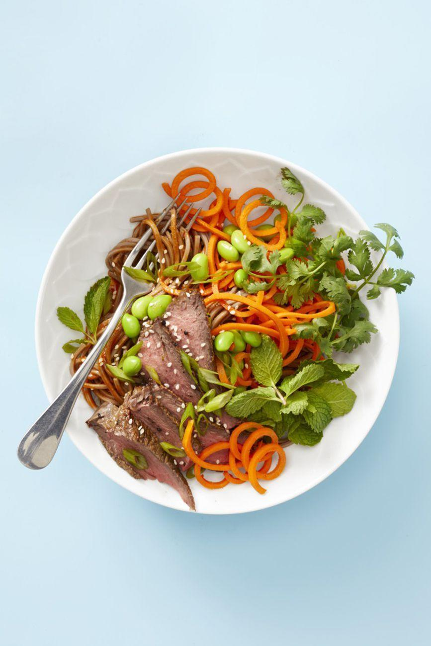 """<p>Who needs the heat? This salad tastes delicious cold. To make it ahead, simply assemble and refrigerate it the day before, omitting the mint, cilantro, sesame seeds, and scallions. Instead, fold them in just before serving.</p><p><em><a href=""""https://www.goodhousekeeping.com/food-recipes/easy/a25336953/asian-steak-noodle-bowl-recipe/"""" rel=""""nofollow noopener"""" target=""""_blank"""" data-ylk=""""slk:Get the recipe for Asian Steak Noodle Bowl »"""" class=""""link rapid-noclick-resp"""">Get the recipe for Asian Steak Noodle Bowl »</a></em></p><p><strong>RELATED: </strong><a href=""""https://www.goodhousekeeping.com/cooking-tools/g28183405/best-spiralizers/"""" rel=""""nofollow noopener"""" target=""""_blank"""" data-ylk=""""slk:8 Best Spiralizers for Making Zoodles, Sweet Potato Noodles, and More"""" class=""""link rapid-noclick-resp"""">8 Best Spiralizers for Making Zoodles, Sweet Potato Noodles, and More</a><br></p>"""