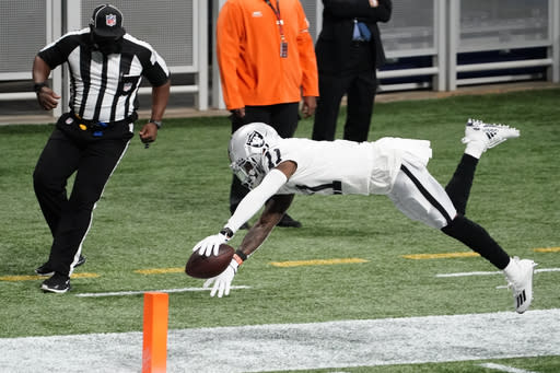 Las Vegas Raiders wide receiver Henry Ruggs III (11) leaps toward the end zone against the Atlanta Falcons during the first half of an NFL football game, Sunday, Nov. 29, 2020, in Atlanta. (AP Photo/Brynn Anderson)