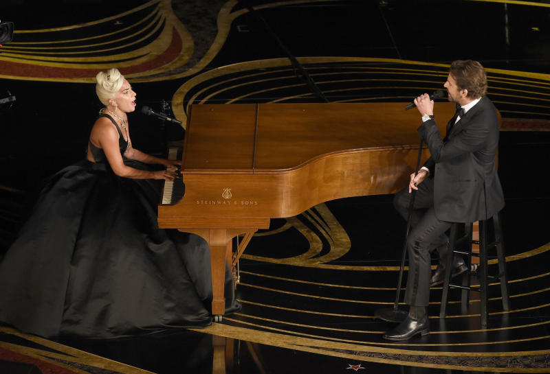 """FILE - This Feb. 24, 2019 file photo shows Lady Gaga, left, and Bradley Cooper performing """"Shallow"""" from """"A Star is Born"""" at the Oscars in Los Angeles. (Photo by Chris Pizzello/Invision/AP, File)"""