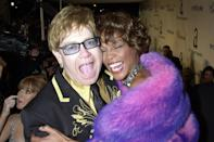 <p>Icons only! Elton John and Whitney Houston shared a laugh and a hug for the camera at Elton's infamous Oscar party. </p>
