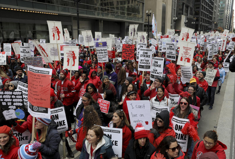 Striking Chicago Public Schools teachers and supporters rally in front of CPS headquarters in downtown Chicago on Thursday, Oct. 17, 2019. (Abel Uribe/Chicago Tribune via AP)