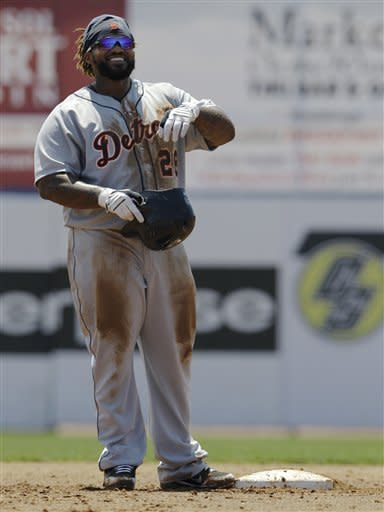 Detroit Tigers' Prince Fielder smiles toward the dugout after stealing second in the third inning of the Tigers loss to the Toronto Blue Jays in their spring training baseball game in Dunedin, Fla., Tuesday, April 3, 2012. (AP Photo/Kathy Willens)