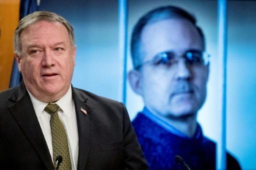 Secretary of State Mike Pompeo holds a news conference in front of an image of Paul Whelan, a former US marine who was arrested for alleged spying in Moscow