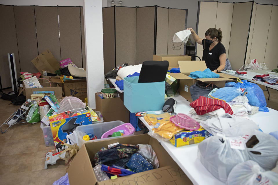 Toys and clothes are sorted in a storage facility at the Naval Station in Rota, southern Spain after the latest flight brought evacuees from Afghanistan on a U.S. airforce plane, in Rota, Tuesday, Aug. 31, 2021. The United States completed its withdrawal from Afghanistan late Monday, ending America's longest war. (AP Photo/ Marcos Moreno)