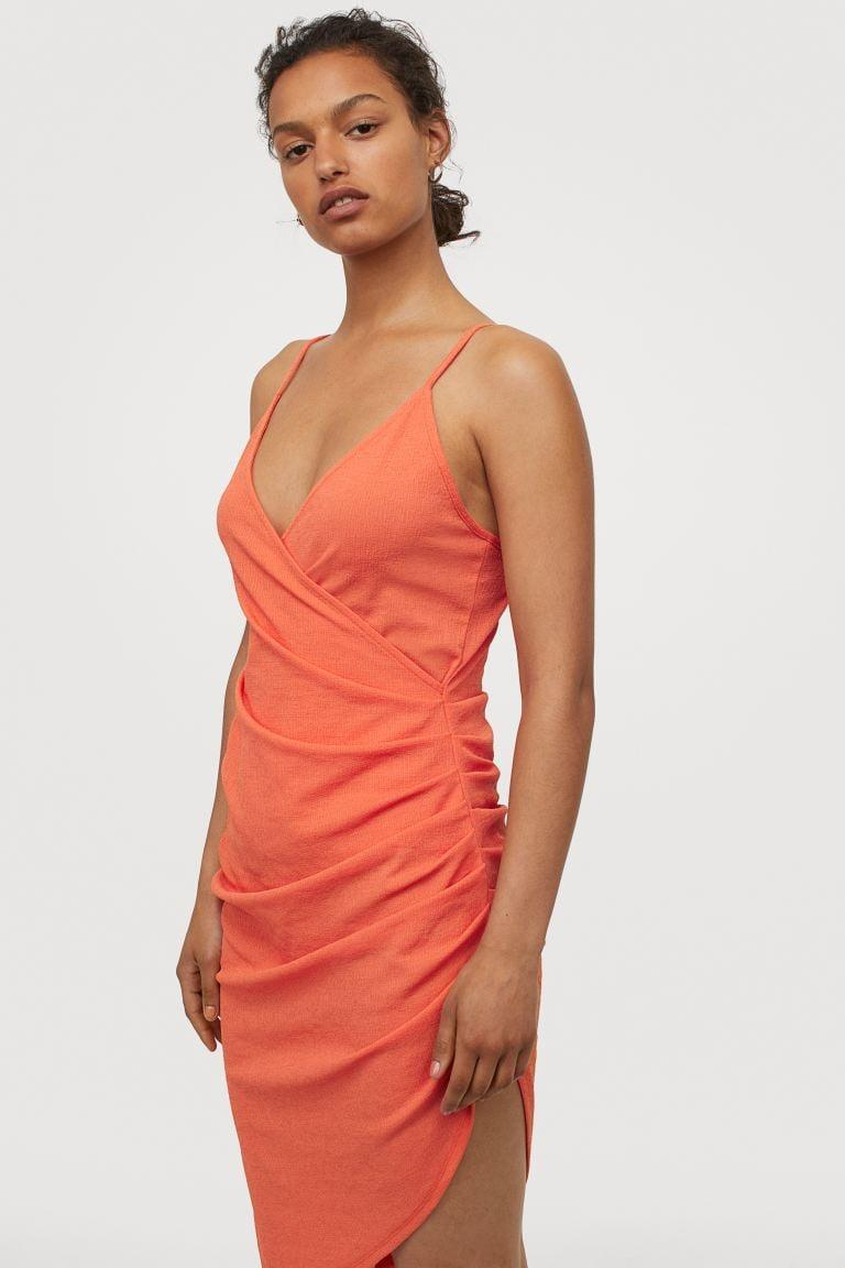 "<p>You'll feel sexy in this <a href=""https://www.popsugar.com/buy/HampM-Draped-Jersey-Dress-580545?p_name=H%26amp%3BM%20Draped%20Jersey%20Dress&retailer=www2.hm.com&pid=580545&price=40&evar1=fab%3Aus&evar9=47523854&evar98=https%3A%2F%2Fwww.popsugar.com%2Ffashion%2Fphoto-gallery%2F47523854%2Fimage%2F47538039%2FHM-Draped-Jersey-Dress&list1=shopping%2Ch%26m%2Csummer%20fashion%2Cfashion%20shopping&prop13=mobile&pdata=1"" class=""link rapid-noclick-resp"" rel=""nofollow noopener"" target=""_blank"" data-ylk=""slk:H&amp;M Draped Jersey Dress"">H&amp;M Draped Jersey Dress </a> ($40).</p>"