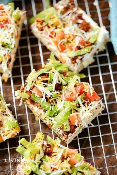 """<p>If tacos and pizza are on your kids' lists of favorite foods, they'll definitely love this dish that combines the two. </p><p><strong>Get the recipe at <a href=""""https://livingwellmom.com/taco-pizza-recipe/"""" rel=""""nofollow noopener"""" target=""""_blank"""" data-ylk=""""slk:Living Well Mom"""" class=""""link rapid-noclick-resp"""">Living Well Mom</a>.</strong> </p><p><a class=""""link rapid-noclick-resp"""" href=""""https://www.amazon.com/Nordic-Ware-Natural-Aluminum-Commercial/dp/B0049C2S32/?tag=syn-yahoo-20&ascsubtag=%5Bartid%7C10050.g.4772%5Bsrc%7Cyahoo-us"""" rel=""""nofollow noopener"""" target=""""_blank"""" data-ylk=""""slk:SHOP BAKING SHEETS"""">SHOP BAKING SHEETS</a></p>"""