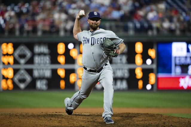 San Diego Padres' Kirby Yates pitches during the ninth inning of a baseball game against the Philadelphia Phillies, Saturday, Aug. 17, 2019, in Philadelphia. (AP Photo/Matt Rourke)