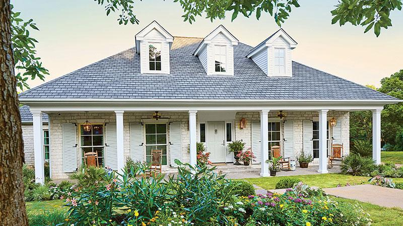 """<p><a href=""""https://houseplans.southernliving.com/plans/SL1973"""" rel=""""nofollow noopener"""" target=""""_blank"""" data-ylk=""""slk:SL-1973"""" class=""""link rapid-noclick-resp"""">SL-1973</a></p> <p>There's something about a white brick ranch with floor-to-ceiling windows and a deep front porch that really sets our hearts aflutter. Step inside for a classic color palette with a splash of personality, gorgeous living spaces, tidy storage solutions, and the kind of details you can only get with a custom build.</p>"""