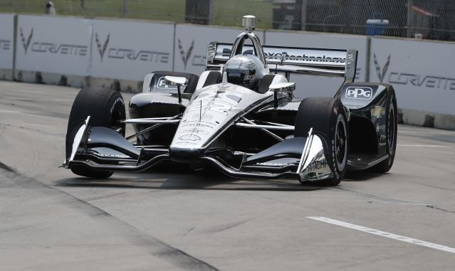 Simon Pagenaud, of France, rounds the seventh turn during practice for the first race of the IndyCar Detroit Grand Prix auto racing doubleheader, Friday, May 31, 2019, in Detroit. (AP Photo/Carlos Osorio)