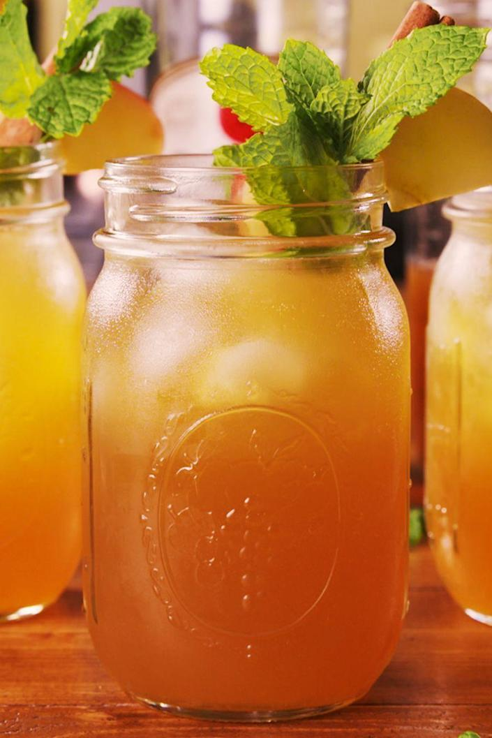 """<p>Mint + cider + rum = surprisingly refreshing!</p><p>Get the recipe from <a href=""""https://www.delish.com/cooking/a23581354/apple-cider-mojitos-recipe/"""" rel=""""nofollow noopener"""" target=""""_blank"""" data-ylk=""""slk:Delish"""" class=""""link rapid-noclick-resp"""">Delish</a>.</p>"""