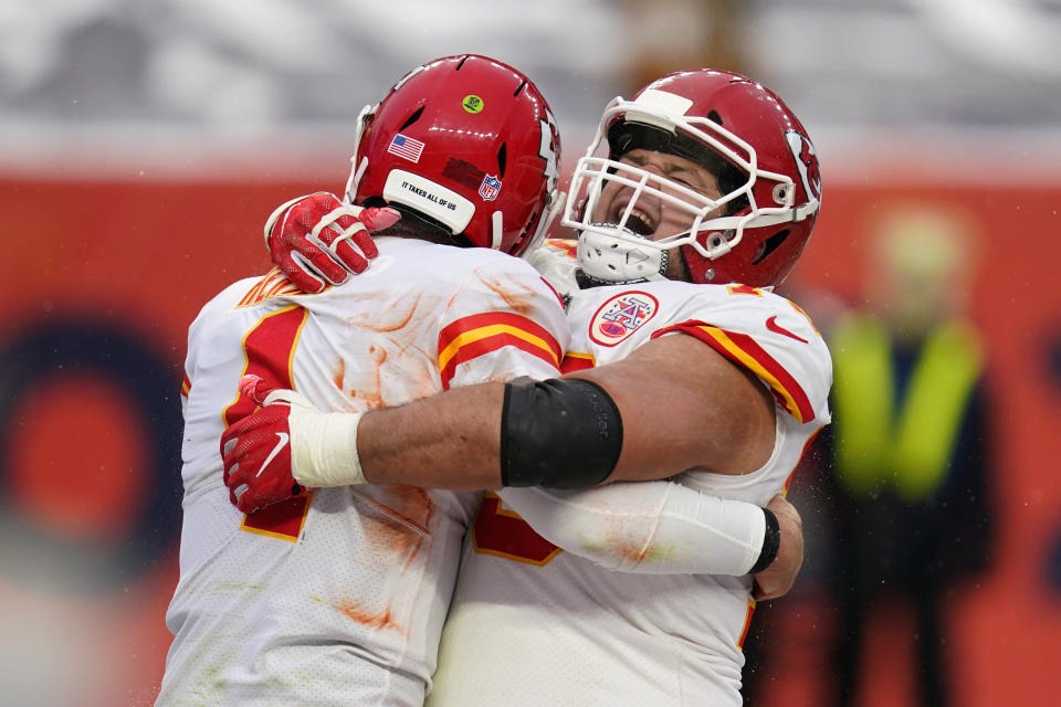 Kansas City Chiefs quarterback Chad Henne, left, celebrates with offensive guard Nick Allegretti after scoring a touchdown during the second half of an NFL football game against the Denver Broncos, Sunday, Oct. 25, 2020, in Denver. (AP Photo/David Zalubowski)