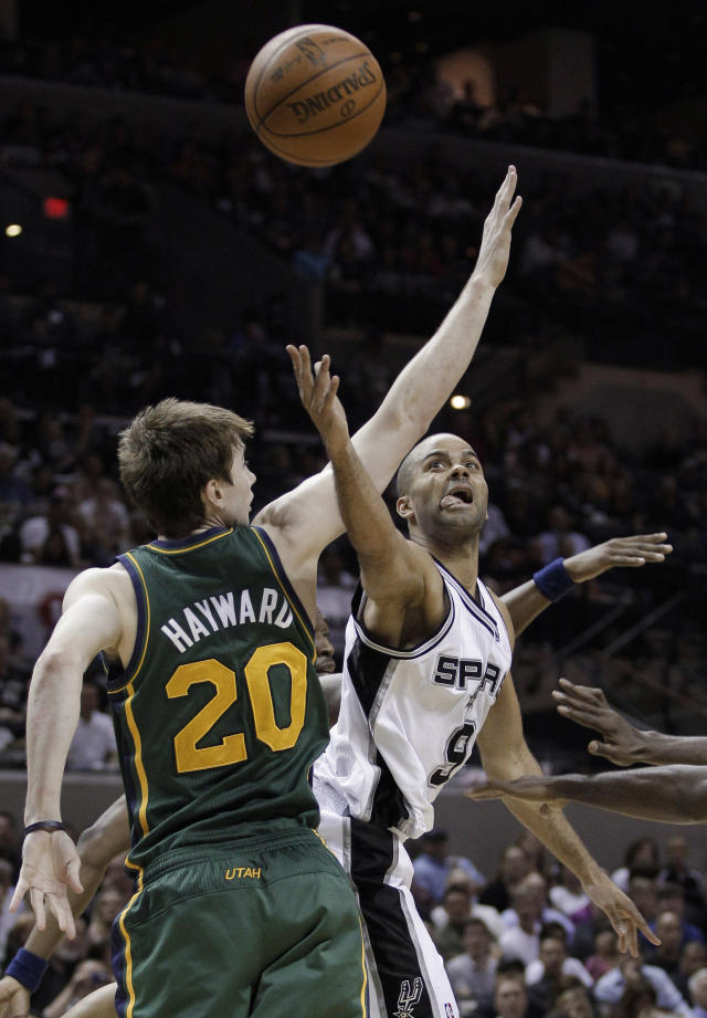 San Antonio Spurs' Tony Parker, right, of France, shoots against Utah Jazz's Gordon Hayward (20) during the third quarter of Game 2 of a first-round NBA basketball playoff series, Wednesday, May 2, 2012, in San Antonio. (AP Photo/Eric Gay)
