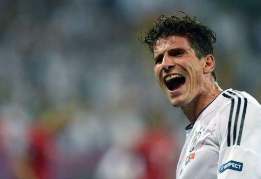 German forward Mario Gomez celebrates after scoring a goal during the Euro 2012 football match against Portugal. Germany won 1-0