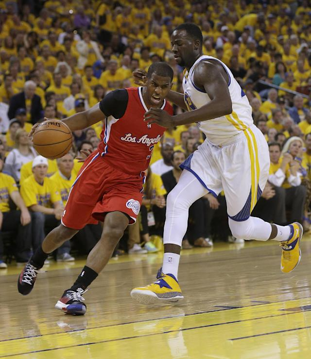 Los Angeles Clippers guard Chris Paul, left, drives to the basket against Golden State Warriors small forward Draymond Green during the first quarter of Game 6 of an opening-round NBA basketball playoff series in Oakland, Calif., Thursday, May 1, 2014. (AP Photo/Marcio Jose Sanchez)