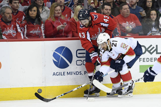 Washington Capitals right wing Tom Wilson (43) battles for the puck against Florida Panthers center Vincent Trocheck (21) during the first period of an NHL hockey game, Saturday, Feb. 9, 2019, in Washington. (AP Photo/Nick Wass)
