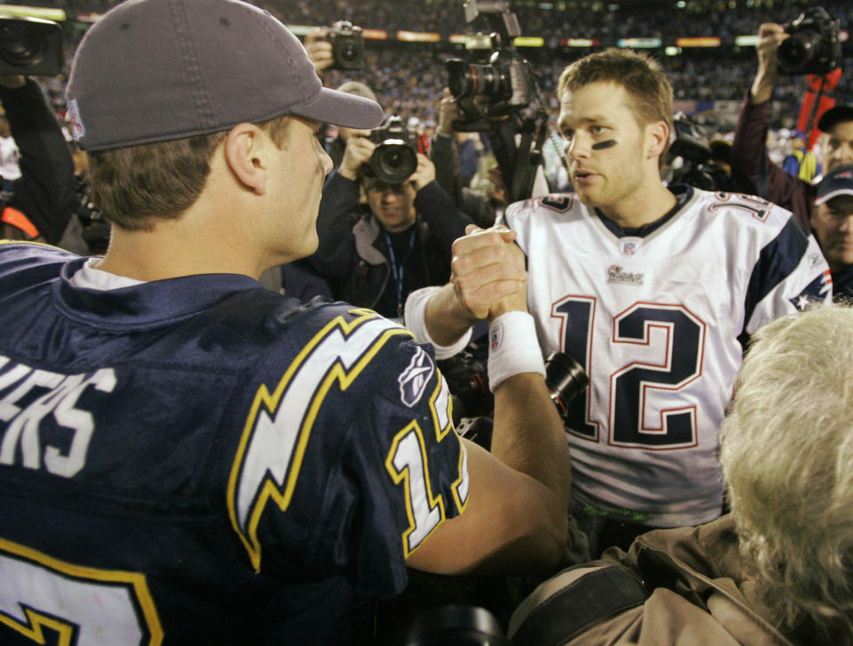 San Diego Chargers quarterback Philip Rivers, left, shakes hands with New England Patriots quarterback Tom Brady following their playoff game at the end of the 2006 season. (AP Photo/Mark J. Terrill)