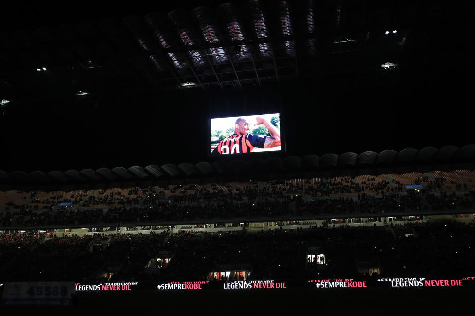 A view of the screen with images in memory of devout fan Kobe Bryant, prior to the start of the Italian Cup soccer match between AC Milan and Torino, at the Milan San Siro Stadium, Italy, Tuesday, Jan. 24, 2020. Bryant, an 18-time NBA All-Star with the Los Angeles Lakers and a lifelong soccer fan, died Sunday with his 13-year-old daughter, Gianna, in a helicopter crash near Calabasas, California. He was 41. (AP Photo/Antonio Calanni)