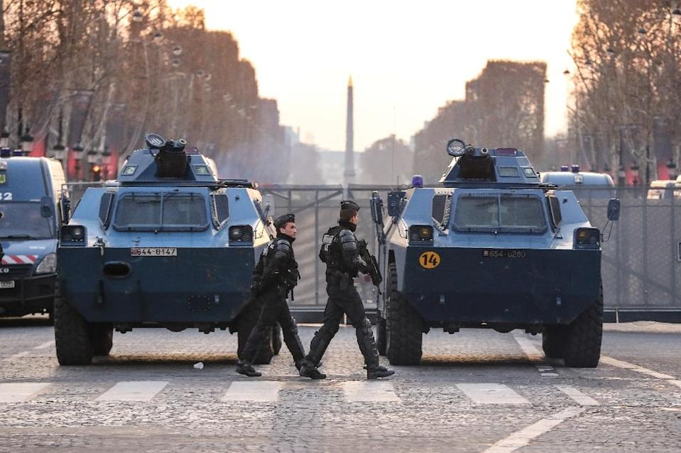 French police blocked the Champs Elysees in Paris ahead of a fifth weekend of protests (AFP Photo/Valery HACHE)