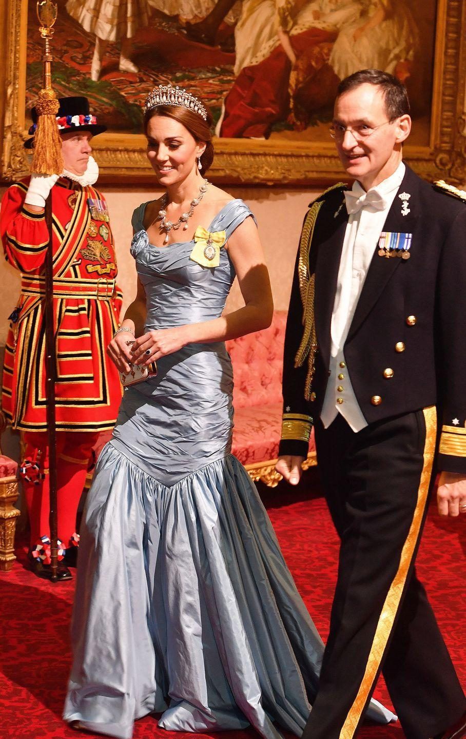 "<p>The Duchess of Cambridge wore an<a href=""https://www.townandcountrymag.com/society/tradition/a24121823/kate-middleton-alexander-mcqueen-blue-dress-dutch-state-banquet/"" rel=""nofollow noopener"" target=""_blank"" data-ylk=""slk:ice blue dress"" class=""link rapid-noclick-resp""> ice blue dress</a> by Alexander McQueen along with a pearl and diamond necklace and <a href=""https://www.townandcountrymag.com/society/tradition/a10302981/cambridge-love-knot-tiara/"" rel=""nofollow noopener"" target=""_blank"" data-ylk=""slk:the Cambridge Lover's Knot tiara"" class=""link rapid-noclick-resp"">the Cambridge Lover's Knot tiara</a> for the State Banquet. </p>"