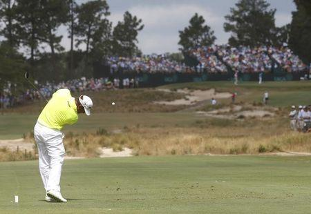 Westwood of England tees off on the 13th hole during the first round of the U.S. Open Championship in Pinehurst