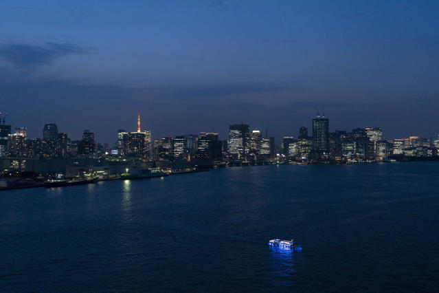A sightseeing boat floats on the Tokyo Bay as the city's skyline is seen from the Rainbow Bridge in Tokyo, June 6, 2019. (AP Photo/Jae C. Hong)
