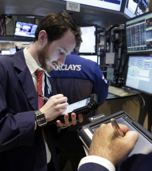 Trader Timothy Pastina, left, works on the floor of the New York Stock Exchange Tuesday, June 11, 2013. Stocks are falling in early trading on Wall Street, following global markets lower after the Bank of Japan declined to take further action to shore up that country's financial system. (AP Photo/Richard Drew)