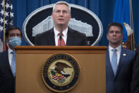 Special Agent in Charge of the Criminal and Cyber Division of the FBI's Washington Field Office James Dawson speaks, Wednesday, Sept. 16, 2020 at the Justice Department in Washington. The Justice Department has charged five Chinese citizens with hacks targeting more than 100 companies and institutions in the United States and abroad, including social media and video game companies as well as universities and telecommunications providers. Officials announced the prosecution on Wednesday. (Tasos Katopodis/Pool via AP)