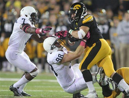 Penn State safety Stephen Obeng-Agyapong and Penn State defensive end Anthony Zettel (98) tackle Iowa fullback Mark Weisman (45) during the first half of an NCAA college football game at Kinnick Stadium in Iowa City, Iowa, Saturday, Oct. 20, 2012. (AP Photo/Justin Hayworth)