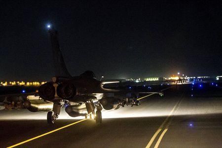 A French fighter jet taxis along the runway in an undisclosed location, in this handout picture released by the ECPAD late November 15, 2015. REUTERS/ECPAD-French Defence Ministry/Handout via Reuters
