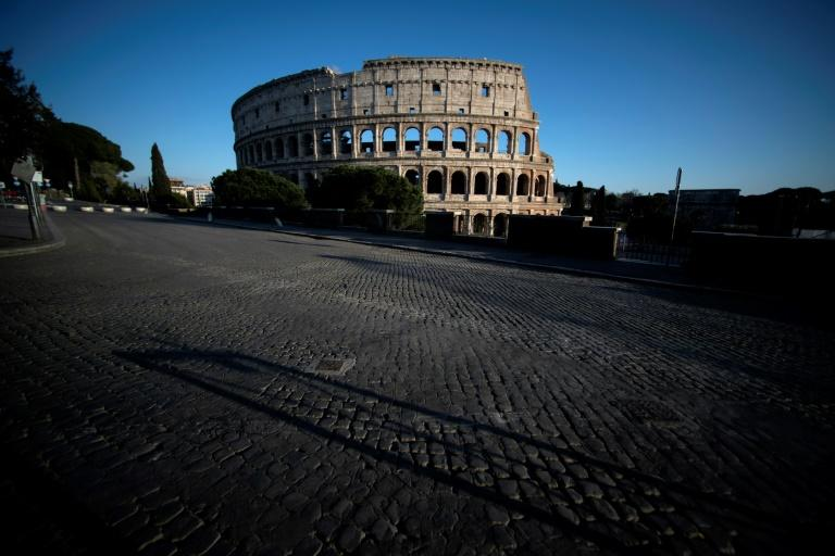 Italians will desperately hope that weeks of living under a lockdown in which even a jog in the park was eventually banned was the price worth paying for beating back the new disease (AFP Photo/Filippo MONTEFORTE)