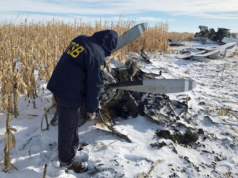 An NTSB air safety investigator begins the initial examination of the wreckage of the Pilatus PC-12 that crashed in Chamberlain, South Dakota: NTSB via AP