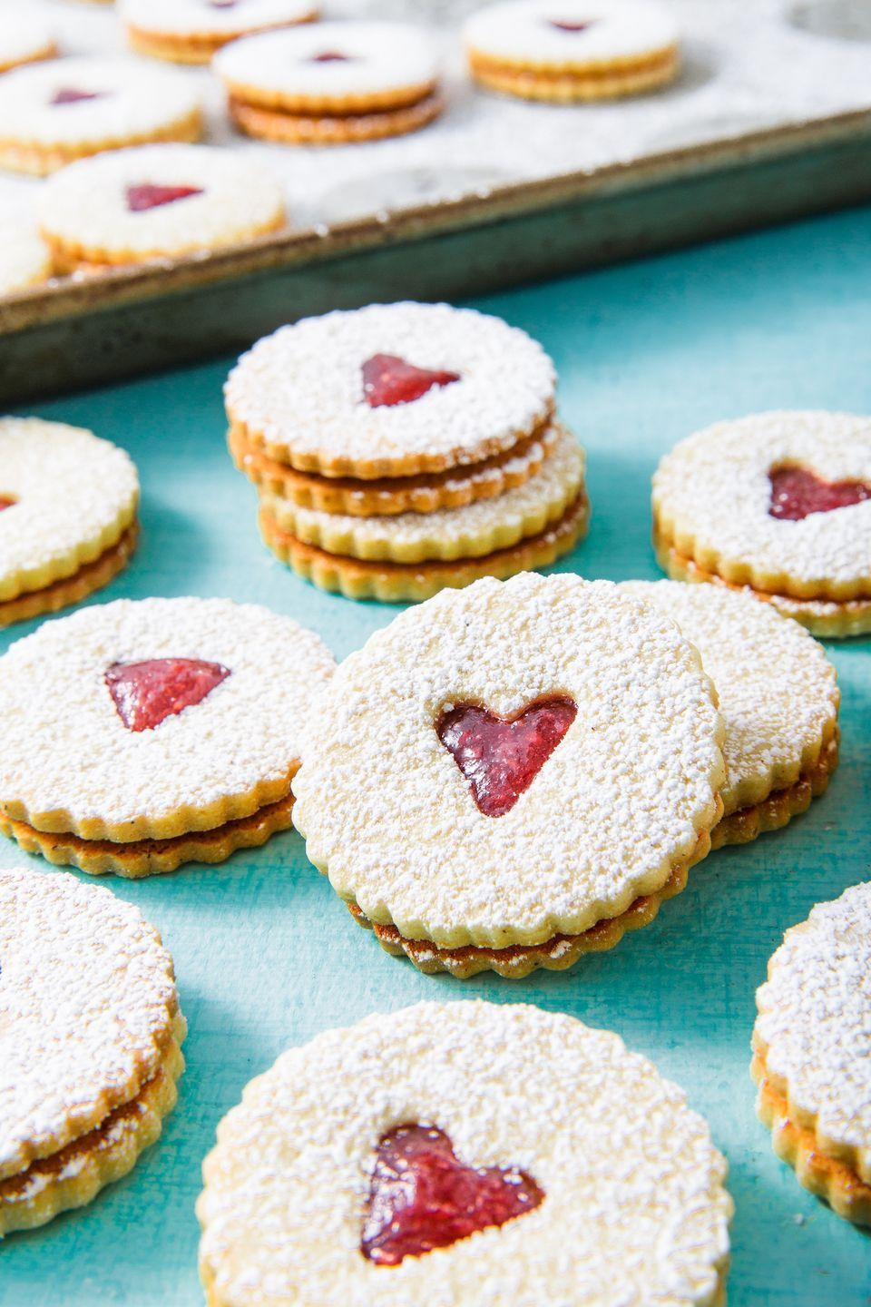 """<p>We love to gift this cookie...and to make a second batch for ourselves. </p><p>Get the recipe from <a href=""""https://www.delish.com/holiday-recipes/christmas/a25400083/classic-linzer-cookies-recipe/"""" rel=""""nofollow noopener"""" target=""""_blank"""" data-ylk=""""slk:Delish"""" class=""""link rapid-noclick-resp"""">Delish</a>. </p>"""