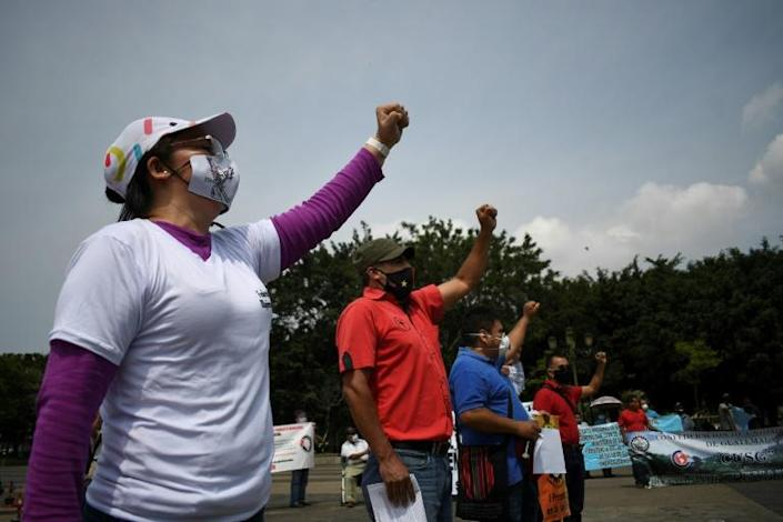 Workers wear face masks during a May Day protest in Guatemala City (AFP Photo/Johan ORDONEZ)