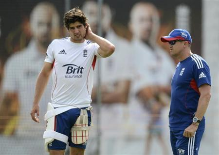 England's captain Alastair Cook (L) rubs his head as he stands with coach Andy Flower before Thursday's second Ashes cricket test match against Australia at Lord's cricket ground in London July 16, 2013. REUTERS/Philip Brown