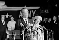 The new president of the United States, Lyndon B. Johnson, speaks at Andrews Air Force Base upon his return to Washington from Dallas, where President John F. Kennedy was shot to death, Nov. 22, 1963. Beside him is new first lady, Lady Bird Johnson. (Photo: AP)