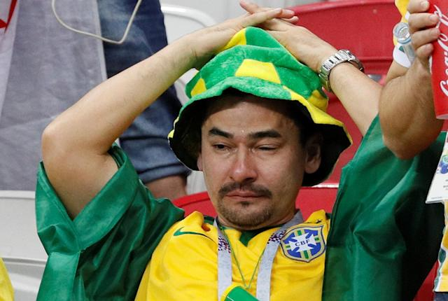 <p>Brazil fan inside the stadium looks dejected after the match REUTERS/Gleb Garanich </p>