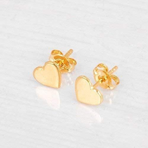 <p>How stunning are these <span>Gold Heart Stud Earrings</span> ($27)!? These minimalistic earrings can be worn every day and are truly timeless.</p>