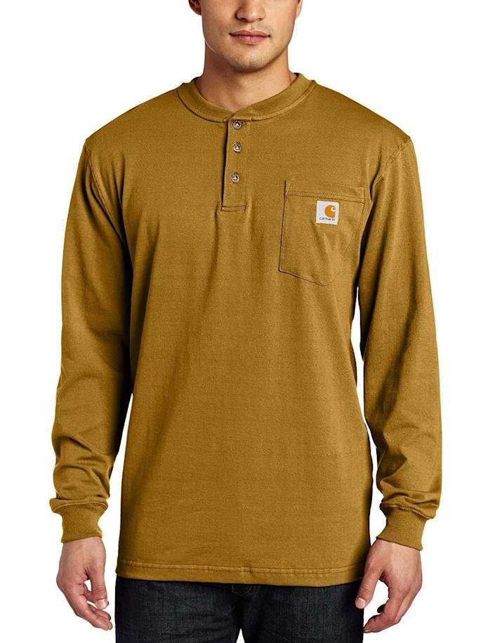 """<h2>Carhartt 100% Cotton Henley</h2><br>Yes, dudes love a T-shirt gift. And yes, dudes love Carhartt. (Actually, <a href=""""https://www.refinery29.com/en-us/shop?q=carhartt"""" rel=""""nofollow noopener"""" target=""""_blank"""" data-ylk=""""slk:ladies love it too"""" class=""""link rapid-noclick-resp"""">ladies love it too</a>.) The heritage workwear brand has been in the throes of a """"moment"""" for several years now, but there's a reason why — they really do make sturdy, heavy-duty, well-designed basics for guys who abuse their clothing. We love a henley-style long-sleeve shirt as a stylish alternative to the classic tee.<br><br><em>Shop Carhartt on <strong><a href=""""https://amzn.to/3itzzmr"""" rel=""""nofollow noopener"""" target=""""_blank"""" data-ylk=""""slk:Amazon"""" class=""""link rapid-noclick-resp"""">Amazon</a></strong></em><br><br><strong>Carhartt</strong> Workwear Pocket Henley Shirt, $, available at <a href=""""https://www.amazon.com/Carhartt-Workwear-Pocket-Regular-X-Large/dp/B000OWFZZ4/ref=sr_1_6"""" rel=""""nofollow noopener"""" target=""""_blank"""" data-ylk=""""slk:Amazon"""" class=""""link rapid-noclick-resp"""">Amazon</a>"""