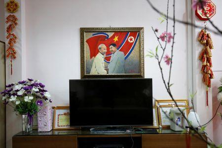 A painting depicting  North Korea's leader Kim Jong-un and Vietnamese late leader Ho Chi Minh is seen at the Vietnam-North Korea Friendship kindergarten which was founded by North Korean Government in Hanoi, Vietnam February 13, 2019. REUTERS/Kham