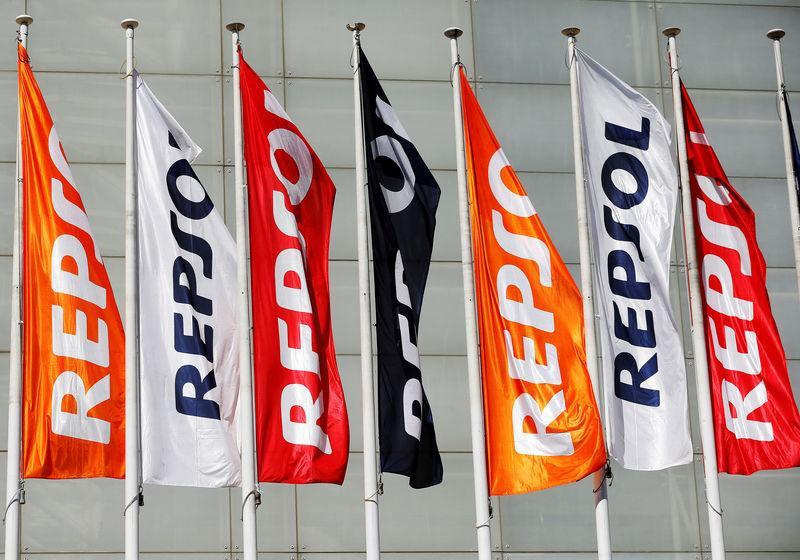 FILE PHOTO: Repsol flags are seen at a conference hall during the company's annual shareholders meeting in Madrid