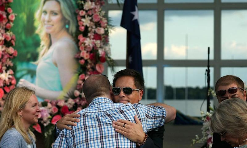 Ms Ruszczyk-Damond's fiancé Don Damond is comforted at the service. Photo: AP