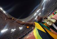 Is Usain Bolt the fastest man in the world or will there be a new champion in London? At the Beijing Games in 2008, Bolt, a Jamaican sprinter, captured the world's eye when he clocked in 9.69 seconds to earn gold and break the world record. He continued to celebrate on the track with his team, posing in front of the clock marking his record time. (Photo by Alexander Hassenstein/Bongarts/Getty Images)