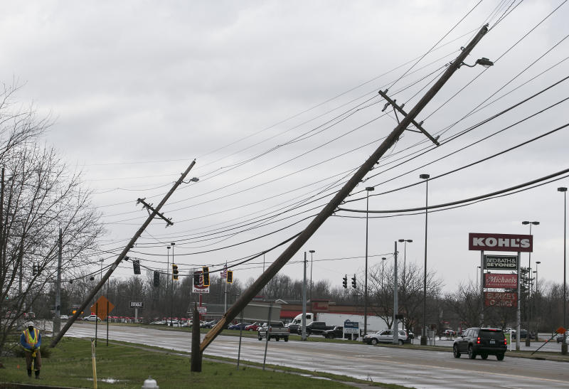 Power lines are down in Paducah, Ky. on Thursday, March 14, 2019. This Thursday, March 14, 2019 photo shows damage to the Wilbert Vault Co., in West Paducah, Ky. A tornado left a path in western Kentucky from Lovelaceville through the West Paducah area, according to Keith Todd, a spokesman for the Kentucky Transportation Cabinet. He said the public was being asked to avoid the area while utility crews, area fire departments, and rescue squads worked to clear utility lines, downed trees and other debris. (Dave Thompson/The Paducah Sun via AP)