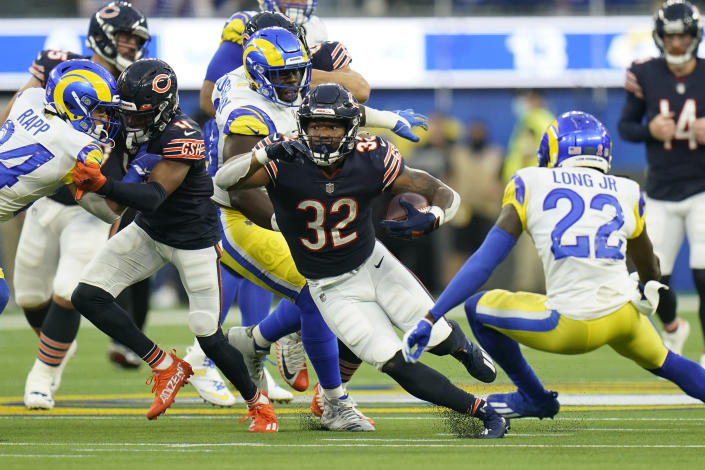 Chicago Bears running back David Montgomery (32) runs with the ball during the first half of an NFL football game against the Los Angeles Rams, Sunday, Sept. 12, 2021, in Inglewood, Calif. (AP Photo/Jae C. Hong)