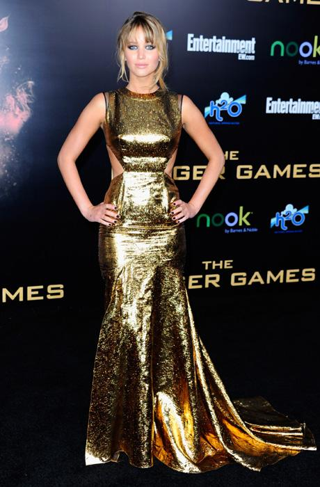 Jennifer Lawrence is a golden girl at the world premiere of 'The Hunger Games' in Los Angeles, March 12. Lawrence wears a stunning Prabal Gurung dress with cut-out panels at the side. We love the futuristic feel of the metallic look. (Photo by Alberto E. Rodriguez/Getty Images)