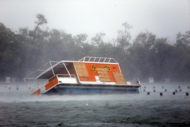 <p><strong>North Miami Beach</strong><br>A floundered boat is shown at the Haulover Marine Center at Haulover Park as Hurricane Irma passes by, Sept. 10, 2017, in North Miami Beach, Fla. (Photo: Wilfredo Lee/AP) </p>