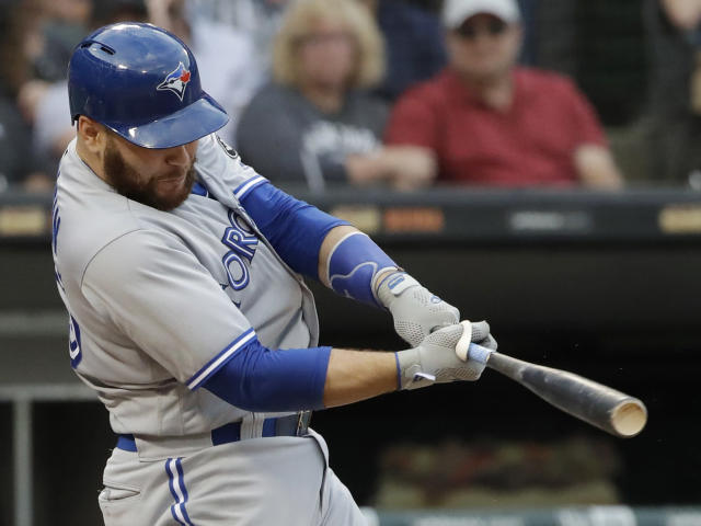 FILE - In this July 28, 2018, file photo, Toronto Blue Jays' Russell Martin hits a solo home run against the Chicago White Sox during the third inning of a baseball game in Chicago. The Los Angeles Dodgers have reacquired catcher Martin in a trade with Toronto, a day after losing free agent Yasmani Grandal to Milwaukee. (AP Photo/Nam Y. Huh, File)