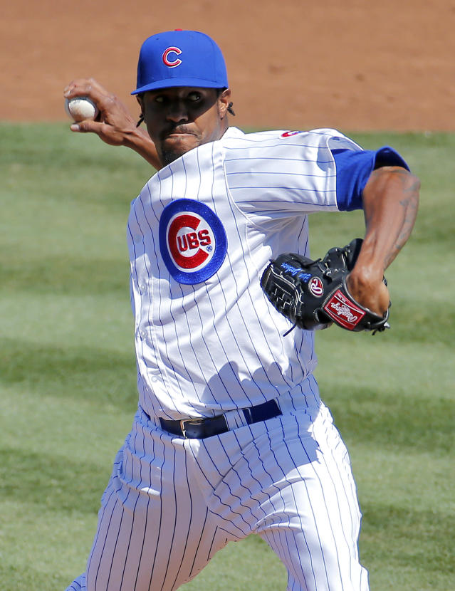 Chicago Cubs pitcher Edwin Jackson throws against the Cincinnati Reds during the third inning of a spring training baseball game, Saturday, March 22, 2014, in Mesa, Ariz. (AP Photo/Matt York)